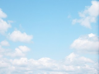 Bright blue sky with clouds