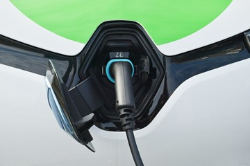 Close up power supply connected to electric car