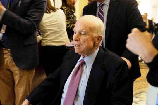 U.S. Senator John McCain (R-AZ) leaves the Senate floor in a wheelchair during debate over the Republican tax reform plan in Washington