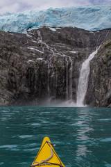 Kayaker watching Blackstone Glacier Melting into the Sea