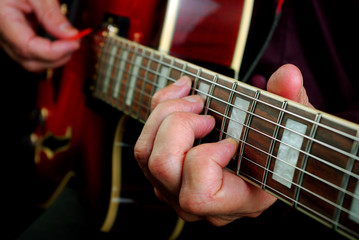 playing electric guitar. play the guitar. closeup.