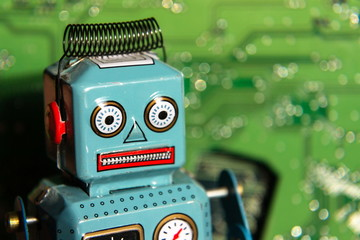 Vintage tin toy robot with computer board, artificial intelligence concept