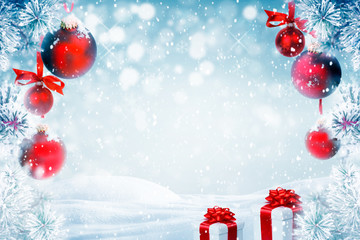 Christmas background with red ornaments, gift boxes and falling snow