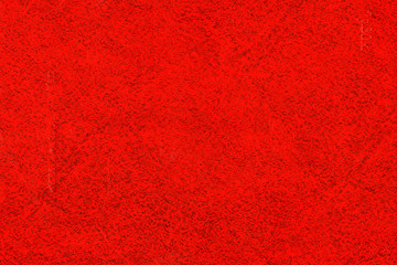 Abstract red background. Texture of the book cover with specks