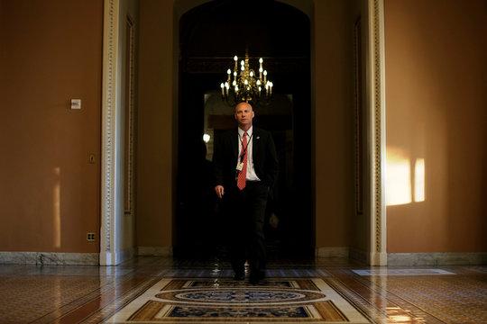 Marc Short, White House Director of Legislative Affairs, walks toward the Senate floor during debate over the Republican tax reform plan in Washington