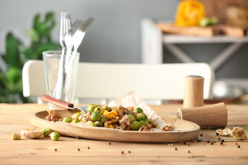 Plate with yummy brussel sprouts salad on wooden table