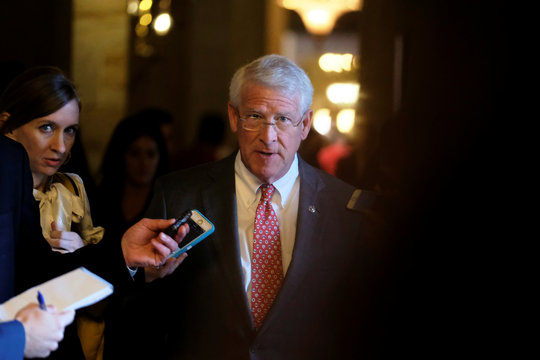 U.S. Senator Wicker speaks to reporters on his way to the Senate floor during debate over the Republican tax reform plan in Washington