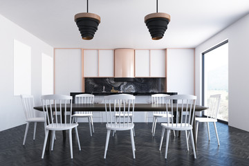 White dining room, poster, bookcases
