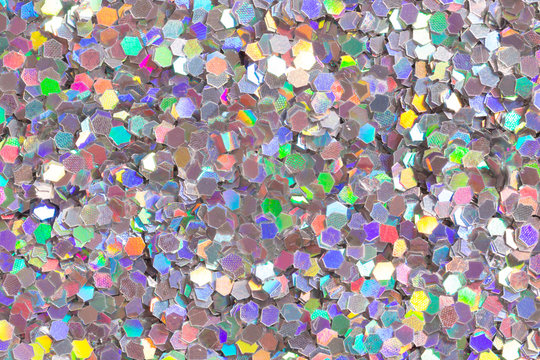 Light colourful background with glitter confetti.