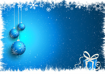 Christmas baubles and gift on snowy background