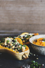 Stuffed Butternut Squash with kale, cranberries, quinoa, and chickpeas
