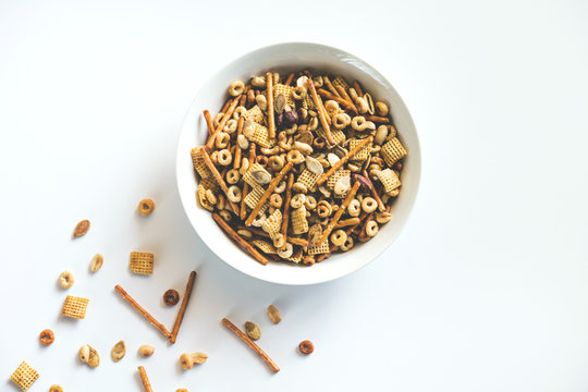 Snack mix with chex, pretzels, nuts, and pumpkin seeds