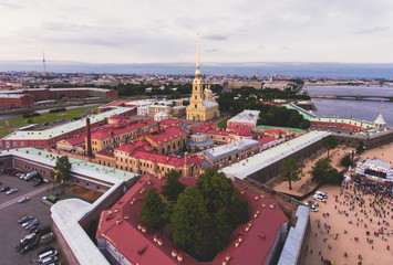Beautiful aerial morning view of Saint-Petersburg, Russia, The Vasilievskiy Island at sunrise, Isaacs Cathedral, Admiralty, Palace Bridge, cityscape and scenery beyond the city, shot from drone