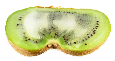 Green kiwifruit with shape defect (flat fruit or kiwi butterfly) cut in half isolated on white background