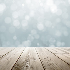 Christmas holiday background with rustic table over white bokeh for product montage