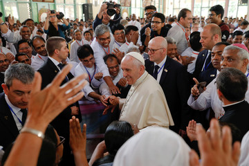 Pope Francis is greeted as he arrives to the Holy Rosary church in Dhaka