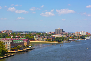 A view on old town Alexandria from the Woodrow Wilson Memorial Bridge, Virginia, USA. Potomac River panorama in early autumn.