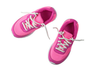 Womens pink sneakers with untied white laces isolated on white background.