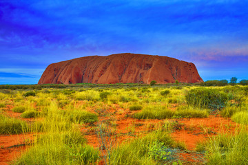 Australia - Uluru - Artificial landscape view of impressive Uluru massive (Ayers Rock), sacred place for indigenous tribe people and UNESCO world heritage site