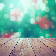 Christmas holiday retro background with rustic table over bokeh for product montage
