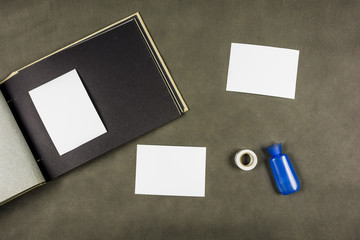 Images prepared for bonding with glue or tape to a photo album.