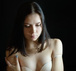 Beautiful brunette in white bra.