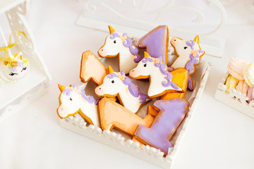 biscuits of various colors in the form of unicorns and figures one