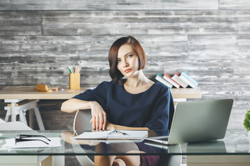 Attractive european business woman working on project