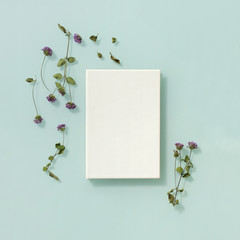 Summer flowers decorated around the book with white cover