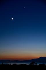 dusk;new moon;waxing moon;starlight;mountain;bay;ocean;red sky;afterglow;wild atlantic way;town lights;distance;dark blue;sunset;golden hour;ireland;bantry bay