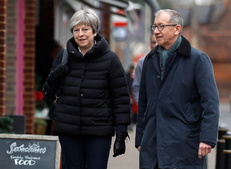 Britain's Prime Minister, Theresa May, and her husband Philip, leave after a visit to VFB The Florist on Small Business Saturday, in Twyford