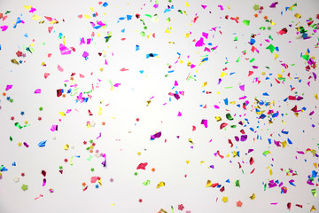 colourful sparlking confetti on white background