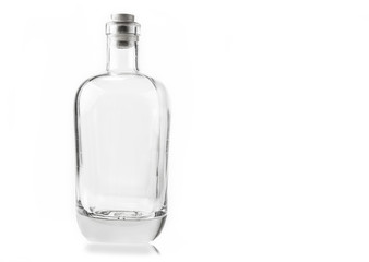 Empty glass bottle with cork on the white background