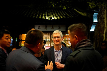 Apple CEO Tim Cook arrives before the fourth World Internet Conference in Wuzhen, Zhejiang province