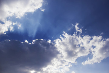 Horizontal photo of a beautiful blue sky rich in clouds and sunlight beam