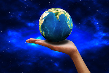 Businessman holding the world in the palm of hands concept for global business, communications, politics or environmental conservation with space background