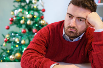 Man in solitude feeling bad during christmas day