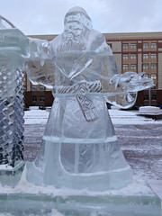 Ice sculpture Santa Claus in a winter city