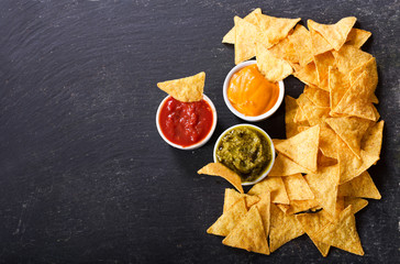 mexican nachos corn chips with guacamole, salsa and cheese dip