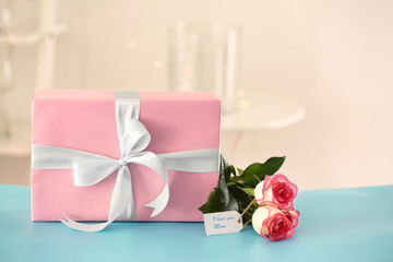 Gift box with flowers for Mother's day on table