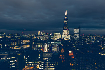 Aerial view of London skyline at night with shard building