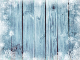 blue wooden texture. Mysterious Christmas night.  Winter. Dark blue christmas background. Snow and snowflakes.