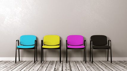 Four CMYK Colored Chairs on Wooden Floor