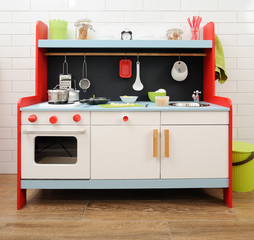 Stylish toy kitchen with utensils ready for making apple pie with children