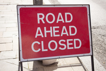 Sign road ahead closed