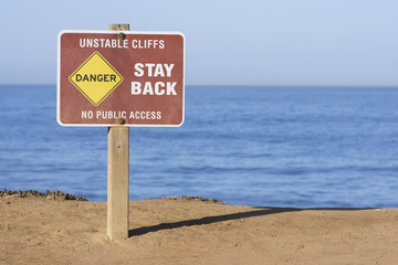 Danger - unstable cliffs sign on seaside bluffs