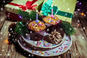Vanilla cupcake with candle on wooden background. Birthday / Christmas greeting card