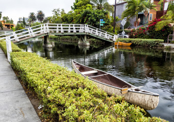 Venice Canals, white bridge and kayak boat - Venice Beach, Los Angeles, California, USA