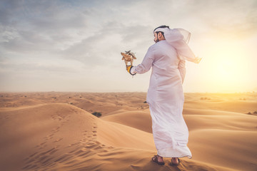 Arabic man in the desert with his hawk