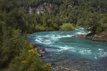 River Futaleufu flowing through a forested valley in the Aysén Region of southern Chile. The river is renowned as one of the premier locations in the world for white water rafting.